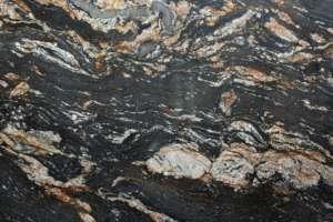 Гранит Magma Gold с золотыми прожилками на чёрном фоне